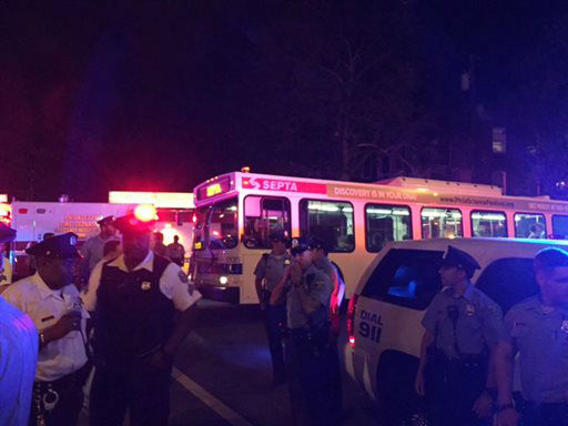 <div class='meta'><div class='origin-logo' data-origin='none'></div><span class='caption-text' data-credit='AP Photo/ Paul Cheung'>Officers gather at the scene of a train crash Tuesday, May 12, 2015, in Philadelphia. An Amtrak train headed to New York City derailed and crashed in Philadelphia.</span></div>