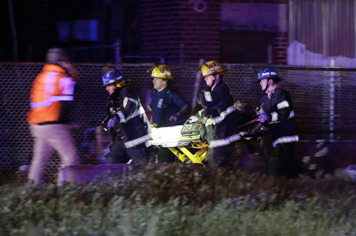 "<div class=""meta image-caption""><div class=""origin-logo origin-image none""><span>none</span></div><span class=""caption-text"">Emergency personnel transport a victim at the scene of a train wreck, Tuesday, May 12, 2015, in Philadelphia. (AP Photo/ Matt Slocum)</span></div>"