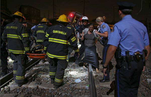 "<div class=""meta image-caption""><div class=""origin-logo origin-image ap""><span>AP</span></div><span class=""caption-text"">Emergency personnel help a passenger at the scene of a train wreck, Tuesday, May 12, 2015, in Philadelphia. (AP Photo/Joseph Kaczmarek)</span></div>"