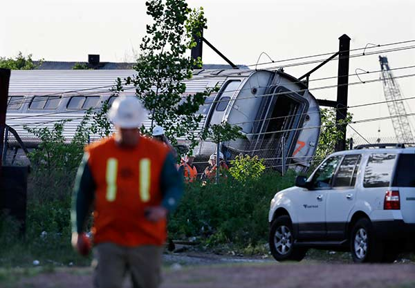 "<div class=""meta image-caption""><div class=""origin-logo origin-image ap""><span>AP</span></div><span class=""caption-text"">Emergency personnel gather near the scene of a deadly train derailment, Wednesday, May 13, 2015, in Philadelphia. (AP Photo/Mel Evans)</span></div>"