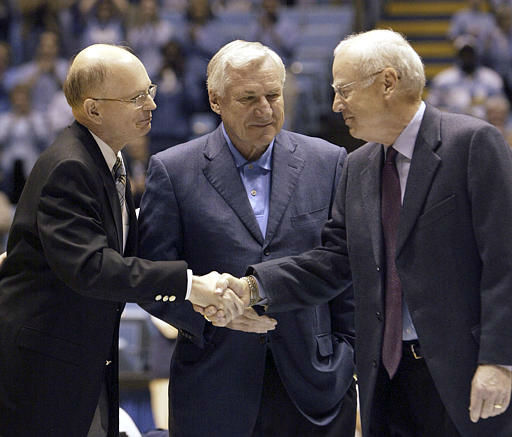 "<div class=""meta image-caption""><div class=""origin-logo origin-image none""><span>none</span></div><span class=""caption-text"">Former UNC coaches Dean Smith, center, and Bill Guthridge, right, shake hands with chancellor James Moeser Saturday, Feb. 21, 2004, at the Smith Center in Chapel Hill, N.C. (AP Photo/Grant Halverson)</span></div>"