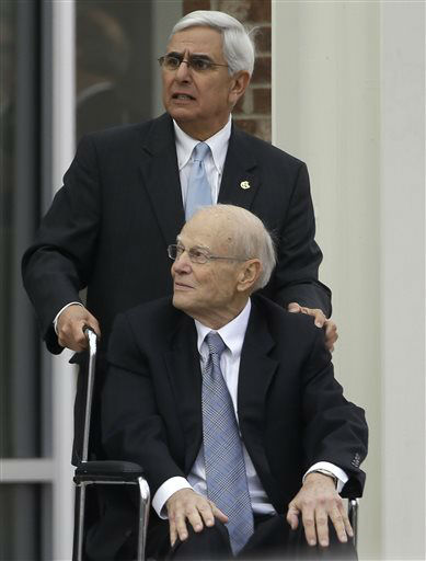 "<div class=""meta image-caption""><div class=""origin-logo origin-image none""><span>none</span></div><span class=""caption-text"">Former UNC Athletic Director Dick Baddour assists former coach Bill Guthridge following funeral services for former Dean Smith in Chapel Hill, Thursday, Feb. 12, 2015. (AP Photo/ Gerry Broome)</span></div>"