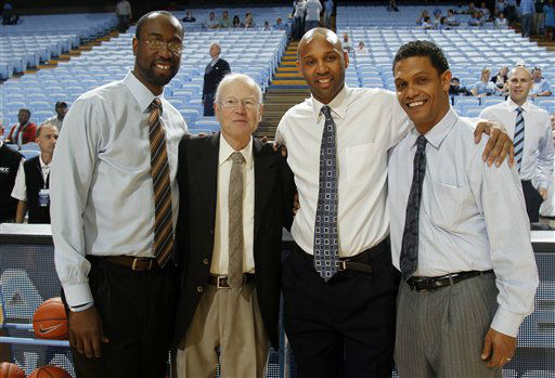"<div class=""meta image-caption""><div class=""origin-logo origin-image none""><span>none</span></div><span class=""caption-text"">Former UNC coach Bill Guthridge, second from left, gathers for a photograph with Monmouth head coach King Rice, far right, Sunday, Jan. 1, 2012. (AP Photo/ Jim R. Bounds)</span></div>"