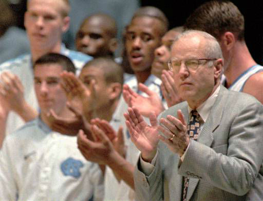 "<div class=""meta image-caption""><div class=""origin-logo origin-image none""><span>none</span></div><span class=""caption-text"">UNC's Bill Guthridge, right, applauds after a Tar Heel basket during his coaching debut against Middle Tennessee State Nov. 14, 1997. (AP Photo/Grant Halverson)</span></div>"