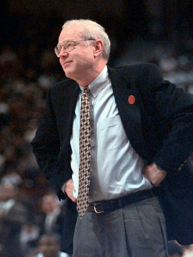 "<div class=""meta image-caption""><div class=""origin-logo origin-image none""><span>none</span></div><span class=""caption-text"">UNC basketball coach Bill Guthridge  watches his players against the University of Carolina-Charlotte March 14, 1998, at the Hartford Civic Center in Hartford, Conn. (AP Photo/ ELISE AMENDOLA)</span></div>"