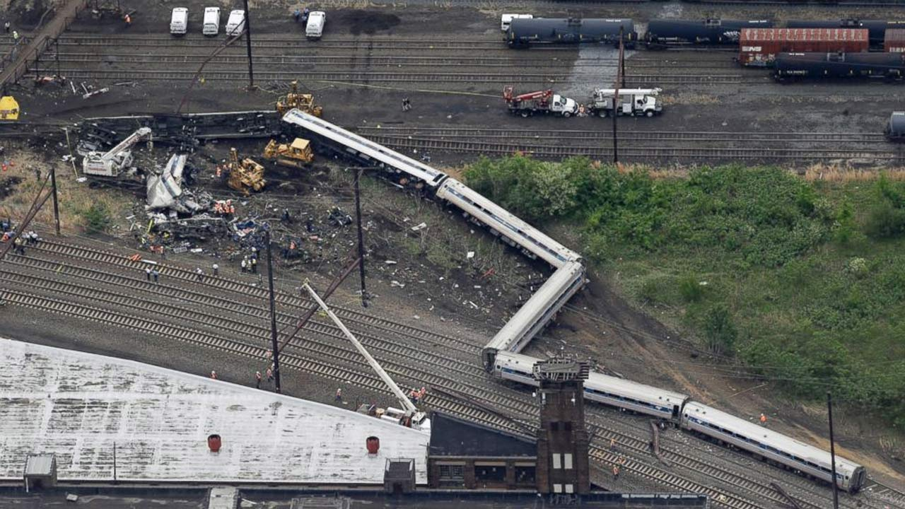 Emergency personnel work at the scene of a deadly train derailment, May 13, 2015, in Philadelphia