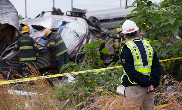 "<div class=""meta image-caption""><div class=""origin-logo origin-image none""><span>none</span></div><span class=""caption-text"">National Transportation Safety Board member Robert Sumwalt on the scene of the Amtrak train 188 derailment in Philadelphia, Pa. (National Transportation Safety Board)</span></div>"