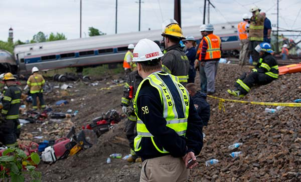 "<div class=""meta image-caption""><div class=""origin-logo origin-image none""><span>none</span></div><span class=""caption-text"">NTSB Member Robert Sumwalt on the scene of the Amtrak Train #188Derailment in Philadelphia, PA (National Transportation Safety Board)</span></div>"
