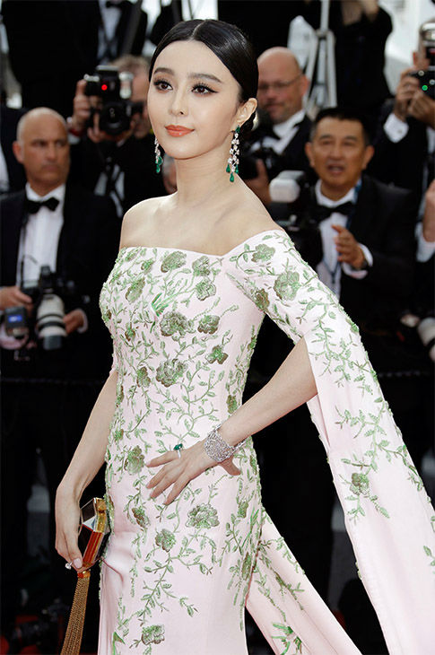 "<div class=""meta image-caption""><div class=""origin-logo origin-image none""><span>none</span></div><span class=""caption-text"">Fan Bingbing arrives for the opening ceremony and screening of the film La Tete en Haut (Standing Tall) at the Cannes 68th international film festival in France May 13, 2015. (Photo/AP)</span></div>"
