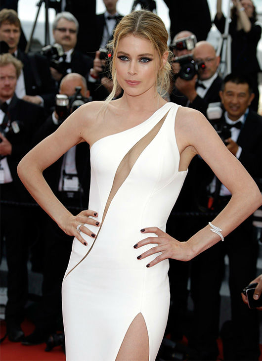 """<div class=""""meta image-caption""""><div class=""""origin-logo origin-image none""""><span>none</span></div><span class=""""caption-text"""">Doutzen Kroes arrives for the opening ceremony and screening of the film La Tete en Haut (Standing Tall) at the Cannes 68th international film festival in France May 13, 2015. (Photo/AP)</span></div>"""