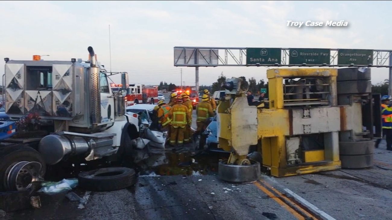 Emergency crews respond to a multi-vehicle crash on the southbound 57 Freeway near Chapman Avenue in Fullerton Wednesday, May 13, 2015.