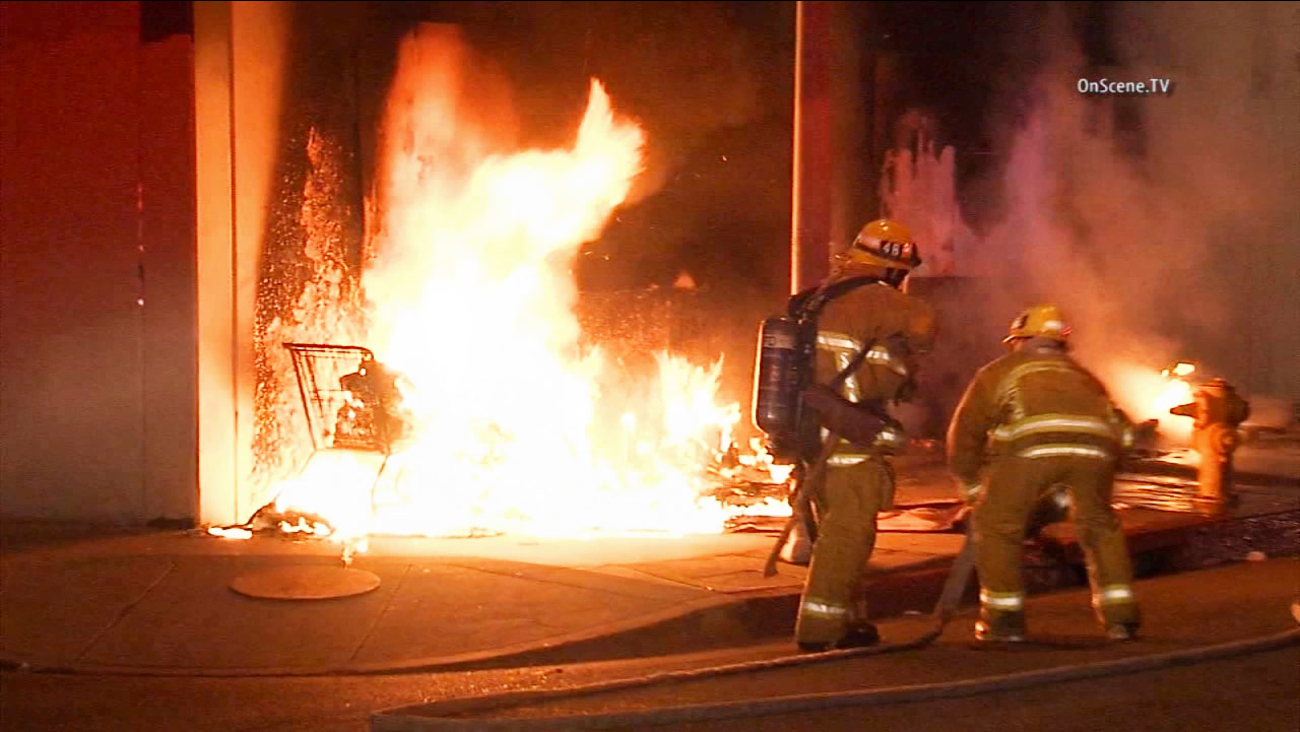 Firefighters work to put out a rubbish fire in South Los Angeles on Thursday, May 14, 2015.