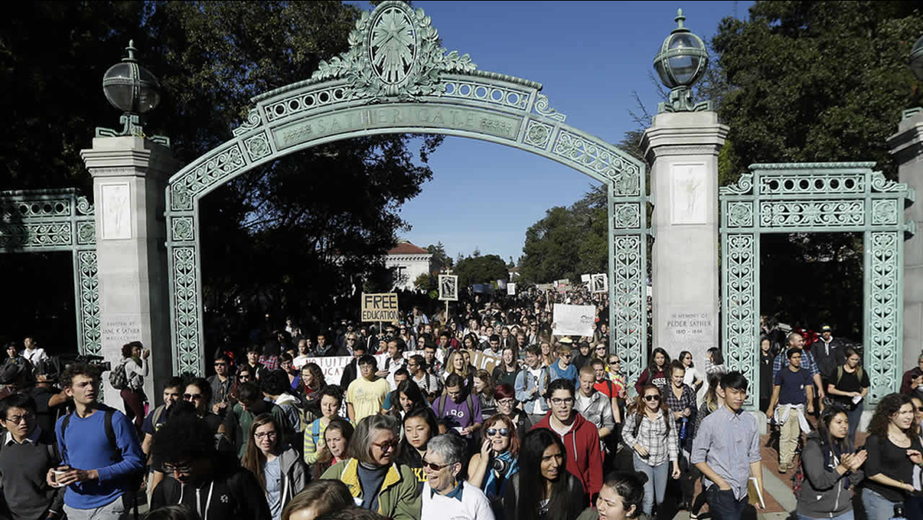Students march under Sather Gate during a protest about tuition increases at the University of California Berkeley in Berkeley.