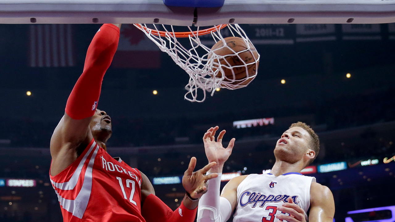 Houston Rockets center Dwight Howard, left, dunks as Los Angeles Clippers forward Blake Griffin watches during the first half of Game 6 in a second-round NBA basketball playoff series in Los Angeles, Thursday, May 14, 2015.