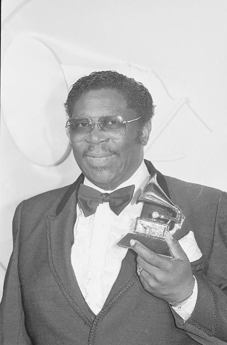 """<div class=""""meta image-caption""""><div class=""""origin-logo origin-image none""""><span>none</span></div><span class=""""caption-text"""">Blues king B.B. King stands with his victrola-shaped trophy he received Wednesday night, February 24, 1982 during the 24th annual Grammy Awards presentations in Los Angeles. (AP Photo/ REED SAXON)</span></div>"""