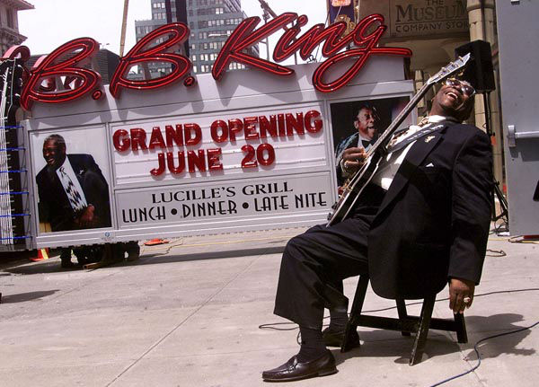 """<div class=""""meta image-caption""""><div class=""""origin-logo origin-image none""""><span>none</span></div><span class=""""caption-text"""">Blues legend B.B. King, holding his guitar """"Lucille,"""" reacts as the neon sign for his New York restaurant and club arrives in Times Square, Thursday afternoon May 25, 2000. (AP Photo/ RICHARD DREW)</span></div>"""
