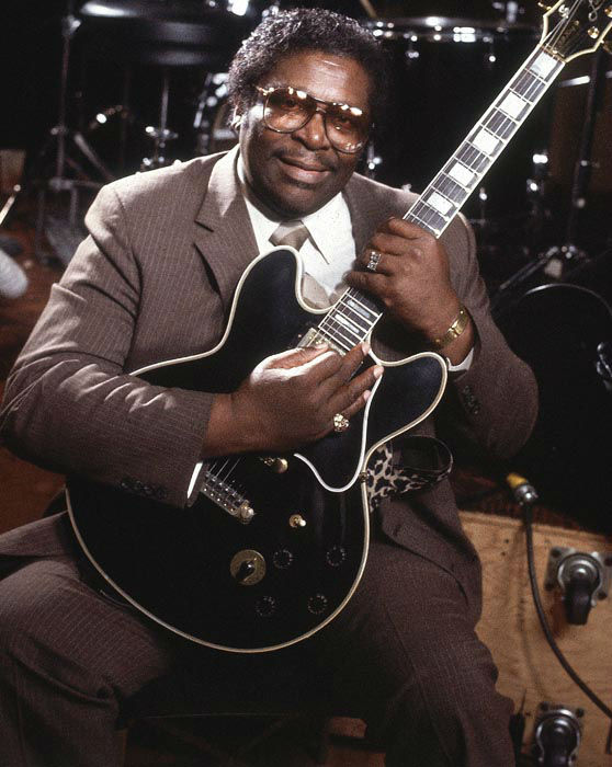 """<div class=""""meta image-caption""""><div class=""""origin-logo origin-image none""""><span>none</span></div><span class=""""caption-text"""">B. B. King holds one of his favorite ladies, his guitar Lucille, in 1996. (AP Photo/ Isaac Sutton)</span></div>"""