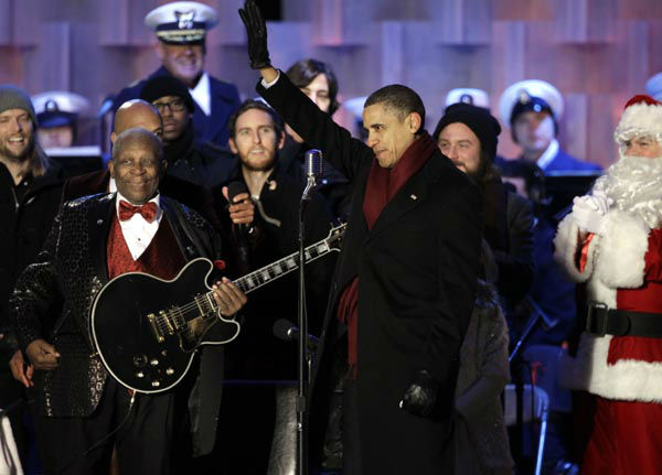 """<div class=""""meta image-caption""""><div class=""""origin-logo origin-image none""""><span>none</span></div><span class=""""caption-text"""">President Barack Obama is pictured on stage with musician B.B. King, members of the band Maroon 5, and Santa Claus at the lighting of the National Christmas Tree (AP Photo/ Charles Dharapak)</span></div>"""