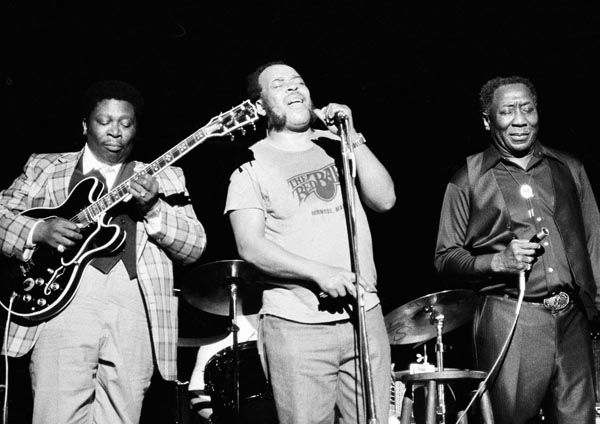 """<div class=""""meta image-caption""""><div class=""""origin-logo origin-image none""""><span>none</span></div><span class=""""caption-text"""">Blues musician B.B. King, left, James Cotton, center, and Muddy Waters perform together at radio city music hall in New York on Friday, June 29, 1979. (AP Photo/ Perez)</span></div>"""