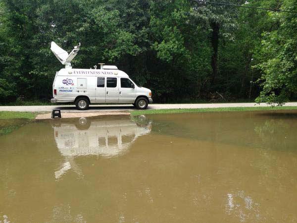"<div class=""meta image-caption""><div class=""origin-logo origin-image none""><span>none</span></div><span class=""caption-text"">Eyewitness News live truck near flood waters (KTRK Photo)</span></div>"