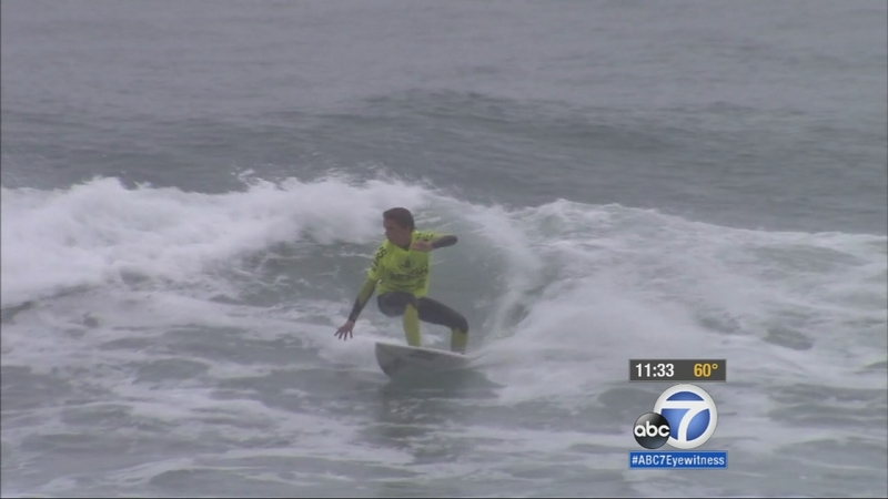 Video Tourists Surfers Welcome Unexpected Storm In Orange County