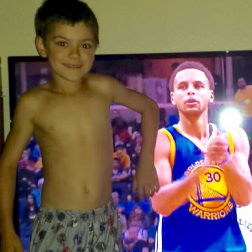 <div class='meta'><div class='origin-logo' data-origin='none'></div><span class='caption-text' data-credit='Photo submitted by annette_curtis via Instagram'>This young Warriors fan poses next to the MVP! Tag your photos on Facebook, Twitter, Google Plus, or Instagram using #DubsOn7!</span></div>