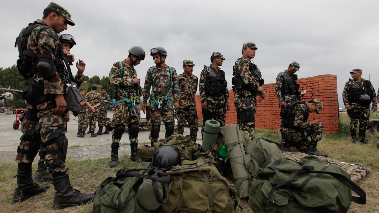 Nepalese soldiers prepare to leave for a rescue mission to the site where the suspected wreckage of a U.S. Marine helicopter was found in Kathmandu, Nepal, Friday, May 15, 2015.