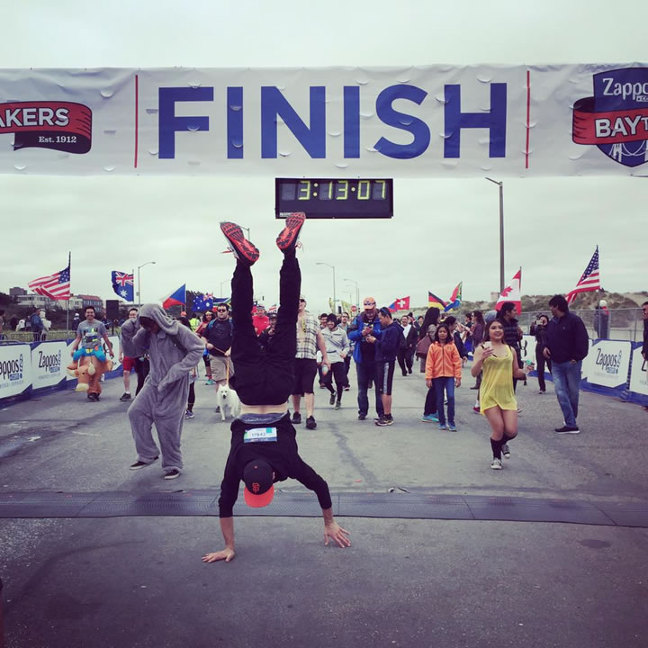"<div class=""meta image-caption""><div class=""origin-logo origin-image none""><span>none</span></div><span class=""caption-text"">A runner does a victory handstand after crossing the finish line of San Francisco's annual Bay to Breakers Race on May 17, 2015. (Photo submitted to KGO-TV by Pearl W./Twitter)</span></div>"