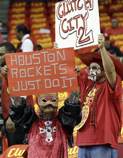 "<div class=""meta image-caption""><div class=""origin-logo origin-image none""><span>none</span></div><span class=""caption-text"">Houston Rockets fans show their support for the team before Game 7 of the NBA basketball Western Conference semifinals (AP Photo/ David J. Phillip)</span></div>"