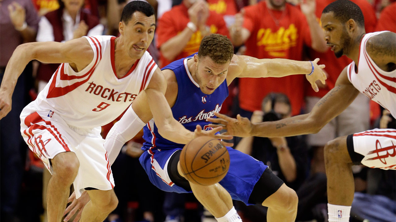 Houston Rockets guard Pablo Prigioni steals the ball from Los Angeles Clippers forward Blake Griffin in Game 7 of the NBA basketball Western Conference semifinals on May 17, 2015.