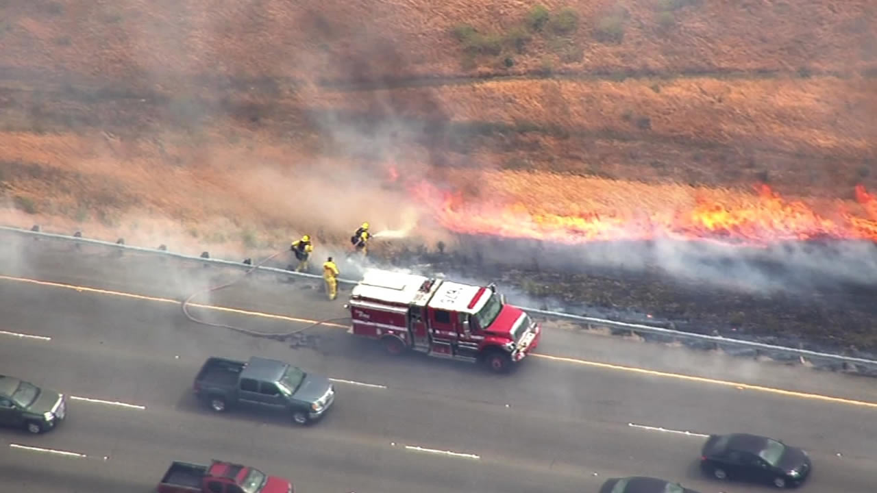 PHOTOS: Crews contain brush fire along Interstate 580 in Altamont