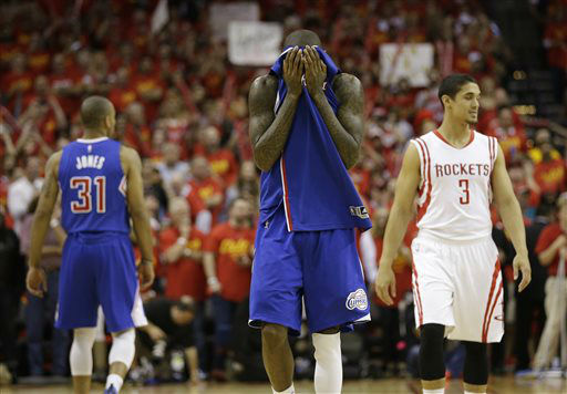 "<div class=""meta image-caption""><div class=""origin-logo origin-image none""><span>none</span></div><span class=""caption-text"">Los Angeles Clippers' Jamal Crawford covers his face as he walks down the court in the closing seconds of the second half in Game 7 (AP Photo/ David J. Phillip)</span></div>"