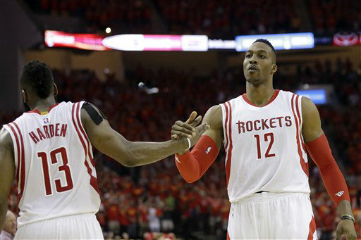 "<div class=""meta image-caption""><div class=""origin-logo origin-image none""><span>none</span></div><span class=""caption-text"">Houston Rockets guard James Harden (13) and center Dwight Howard (12) celebrate during the final moments (AP Photo/ David J. Phillip)</span></div>"