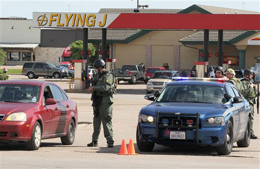 """<div class=""""meta image-caption""""><div class=""""origin-logo origin-image none""""><span>none</span></div><span class=""""caption-text"""">Authorities investigate a shooting in the parking lot of the Twin Peaks restaurant Sunday, May 17, 2015, in Waco, Texas (AP Photo/ Jerry Larson)</span></div>"""
