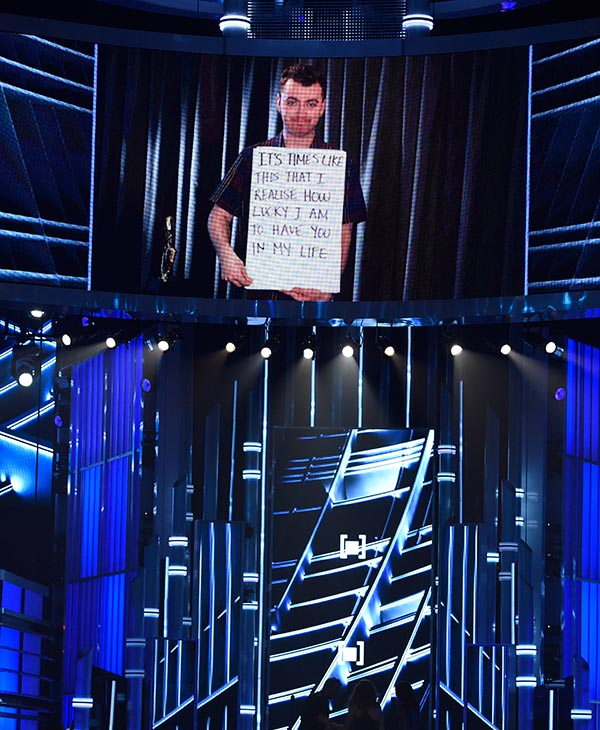 """<div class=""""meta image-caption""""><div class=""""origin-logo origin-image ap""""><span>AP</span></div><span class=""""caption-text"""">Sam Smith is seen on screen accepting the award for top male artist at the Billboard Music Awards at the MGM Grand Garden Arena on Sunday, May 17, 2015, in Las Vegas. (AP)</span></div>"""