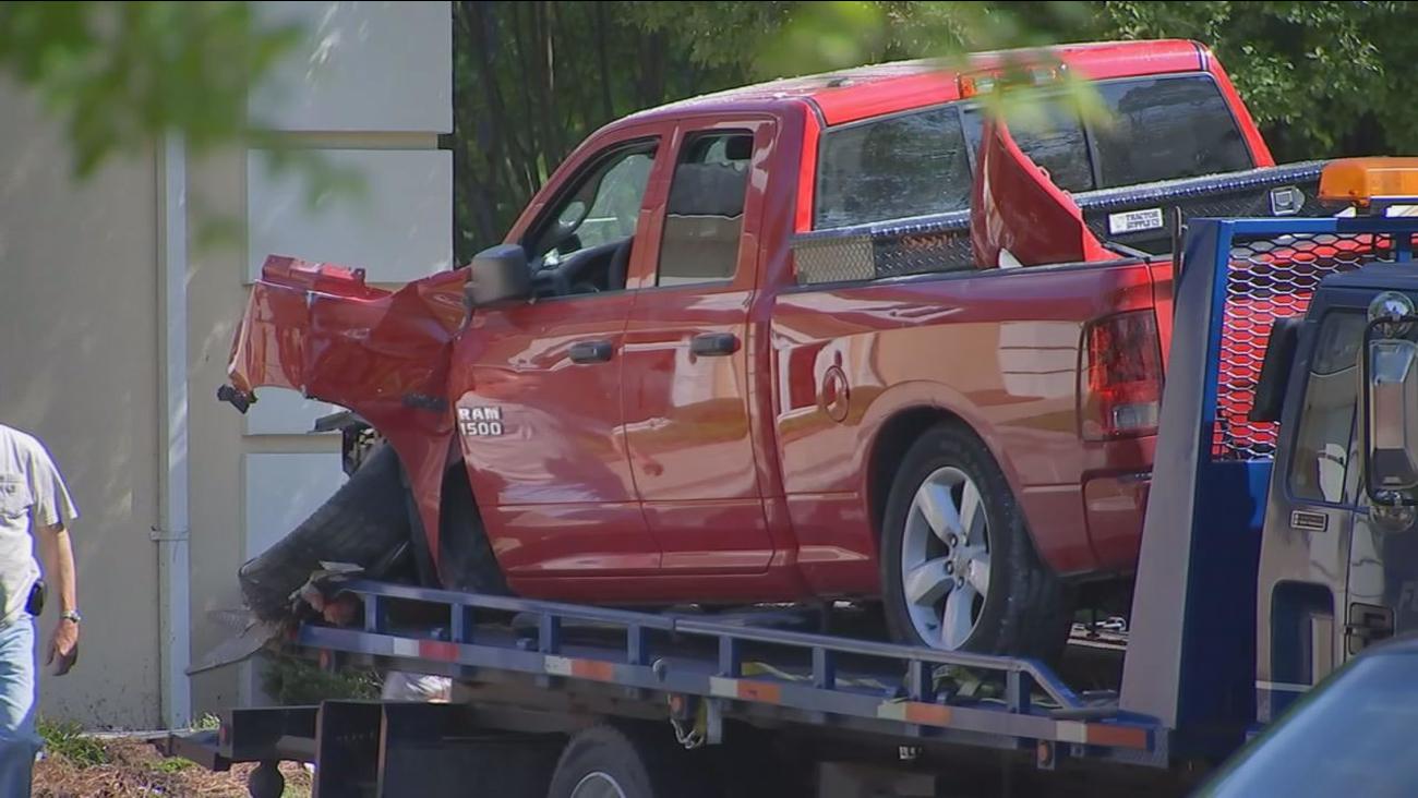 Pick-up truck hits bank in Zebulon