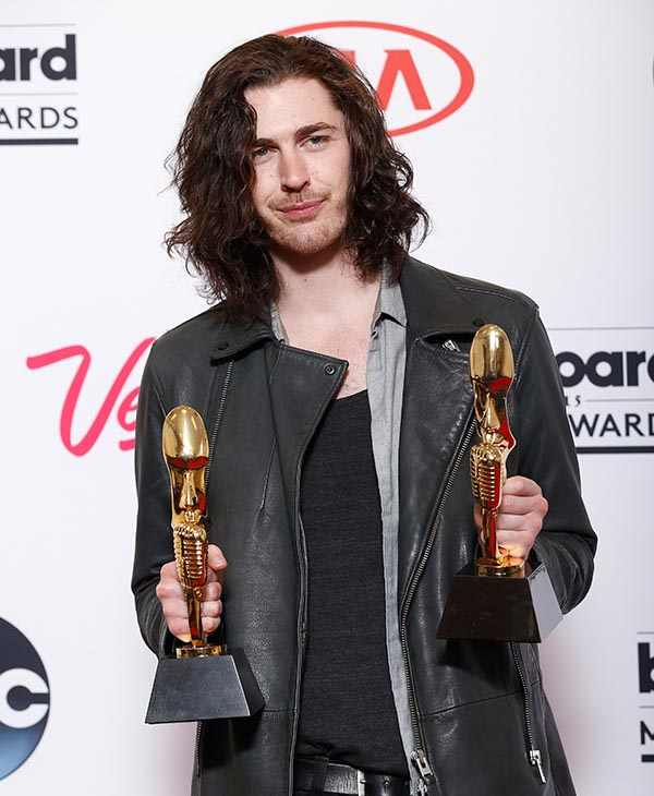 """<div class=""""meta image-caption""""><div class=""""origin-logo origin-image ap""""><span>AP</span></div><span class=""""caption-text"""">Hozier poses in the press room with the awards for top rock artist and top rock song for """"Take Me to Church"""" at the Billboard Music Awards at the MGM Grand Garden Arena. (AP)</span></div>"""