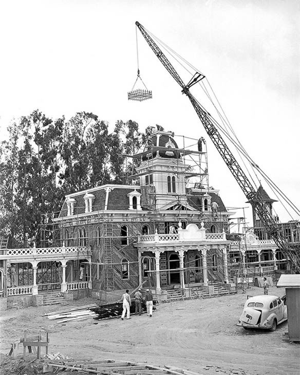 "<div class=""meta image-caption""><div class=""origin-logo origin-image none""><span>none</span></div><span class=""caption-text"">A crane lifts the large metal cresting that rests atop City Hall. This opening day building is still an iconic landmark in Town Square on Main Street, U.S.A. (Disneyland Resort/ABC News)</span></div>"