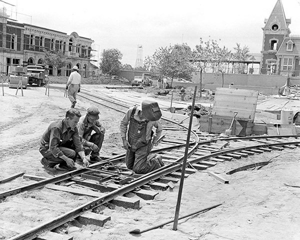 "<div class=""meta image-caption""><div class=""origin-logo origin-image none""><span>none</span></div><span class=""caption-text"">Workers lay the foundation of the trolley tracks along Main Street. Horse-drawn streetcars travel on these tracks today, going between Town Square and Sleeping Beauty Castle. (Disneyland Resort/ABC News)</span></div>"
