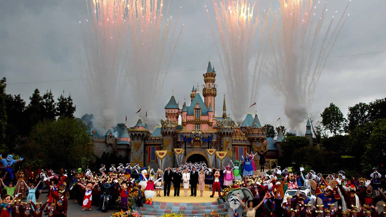 Disney Executives, characters and guests stand in front of the refurbished Castle during Disney's 50th Anniversary Global Celebration Event at Disneyland in Anaheim, May 5, 2005. (AP Photo/Ann Johansson)