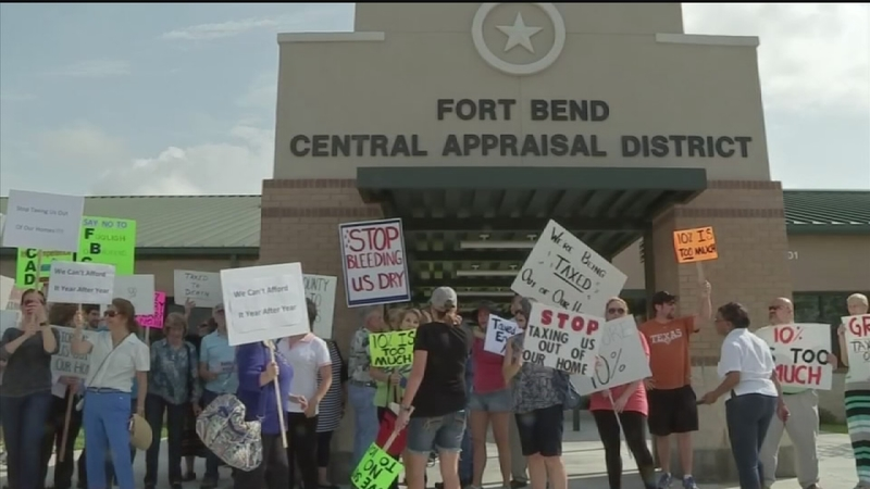 Angry residents protest rising property taxes