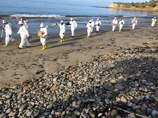 "<div class=""meta image-caption""><div class=""origin-logo origin-image kabc""><span>KABC</span></div><span class=""caption-text"">Cleanup crews walk down Refugio State Beach, site of an oil spill, Wednesday, May 20, 2015. (Edgar Alcala)</span></div>"