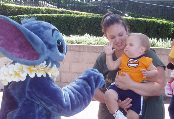"""<div class=""""meta image-caption""""><div class=""""origin-logo origin-image none""""><span>none</span></div><span class=""""caption-text"""">This baby is giving Stitch a high five! ABC7 News viewers and staff are celebrating Disneyland's 60 years of magic by sharing photos of themselves at the park. (Photo submitted to KGO-TV by Amy E/Twitter)</span></div>"""