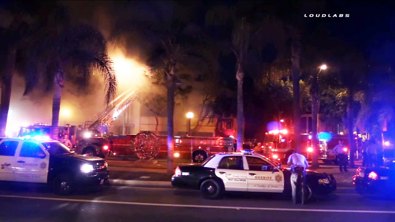 Emergency crews are shown at the scene of a building fire in the 9000 block of West Melrose Avenue in West Hollywood on Thursday, May 21, 2015.