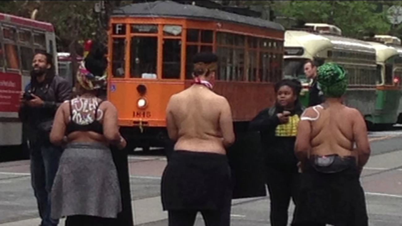 A group of women protesting police killings of black women raised awareness of the issue by taking off their tops and blocking traffic in San Francisco, May 21, 2015.