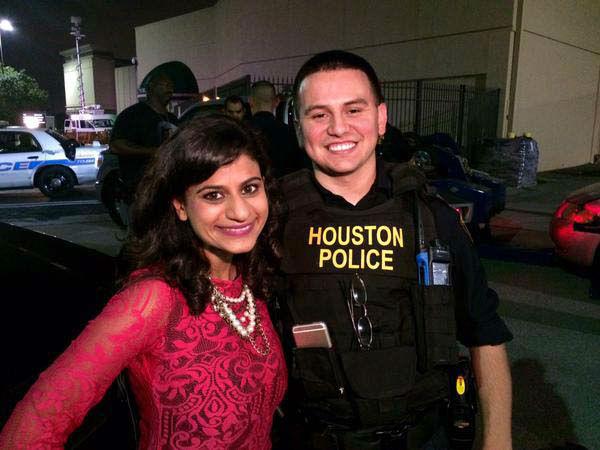 "<div class=""meta image-caption""><div class=""origin-logo origin-image none""><span>none</span></div><span class=""caption-text"">Pooja Lodhia with a Houston police officer (KTRK Photo)</span></div>"
