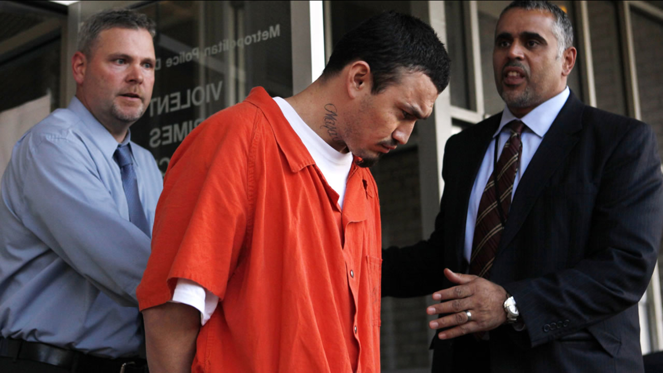 FILE - In this April 22, 2009 file photo, Ingmar Guandique, accused of killing Washington intern Chandra Levy, is escorted from the Violent Crimes Unit in Washington. (AP Photo)