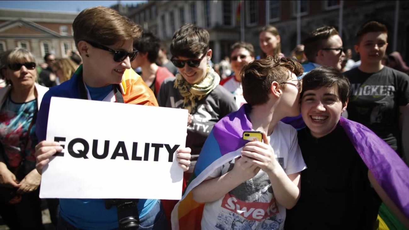 Gay marriage supporters celebrate as first results begin to filter through in referendum at Dublin castle, Ireland, Saturday, May 23, 2015.