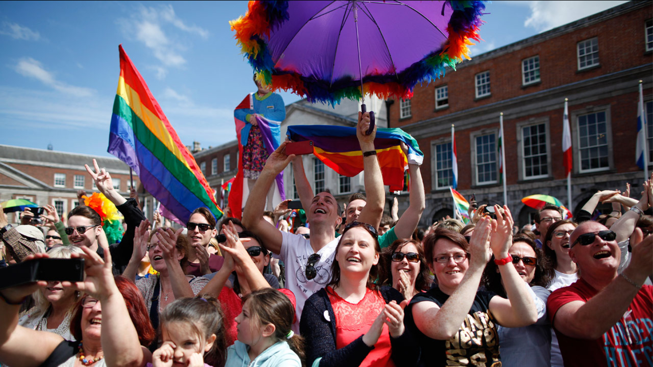 Yes supporters celebrate as results stat to filter through at Dublin castle, Ireland, Saturday, May 23, 2015.