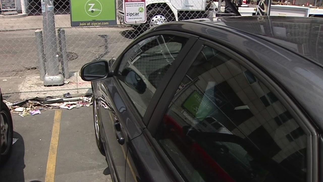 A Zipcar is parked in a San Francisco  parking lot.